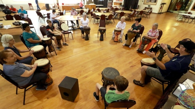 Book a therapeutic group hand drum circle experience